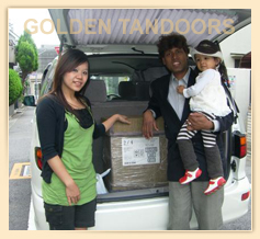 Indian couple Taking Tandoor Delivery