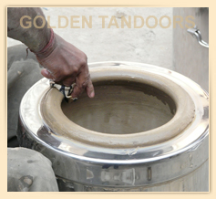 An Artisan giving final touches to a home tandoor